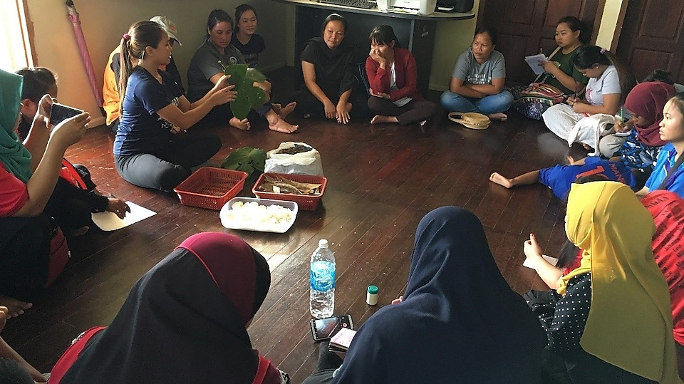 Irene conducting training with the Women's Group of Kg Gana in Kota Marudu, Sabah.